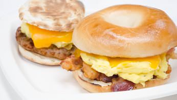 Hot breakfast sandwiches with egg, cheese and choice of sausage or bacon