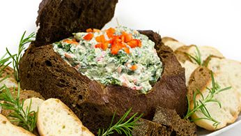 Classic spinach and shrimp dips in pumpernickel bread bowls