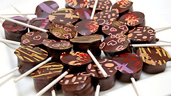 Chocolate-dipped brownie lollipops